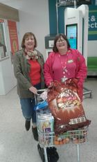 Lyn Hopson and Carolyn Halls from ASDA collecting refreshments